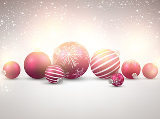 Winter background with magenta christmas balls.