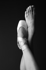 Elegant ballerina's feet in one pointe, monochrome