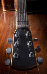 Dusty acoustic guitar,still life.
