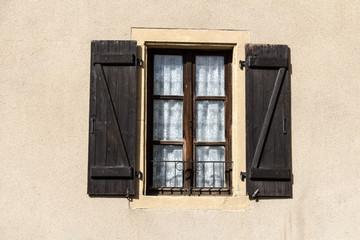 Old wooden shutters on window in Metz, Alsace, France