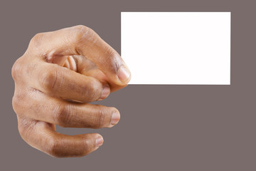 Hand holding a business card over gray background