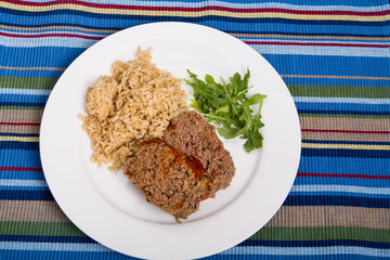 Meatloaf Rice and Arugula on Striped Placemat