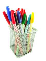 color pens in a basket