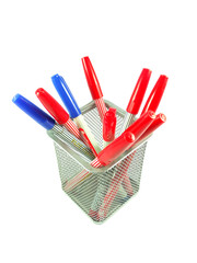 Red and Blue magic color pens on white background
