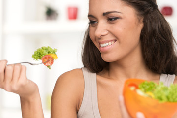 sexy smiling woman eating salad.