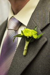 Flower boutonniere on the lapel