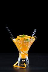 Orange Mojito over dark background