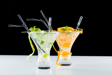 Orange and lime Mojito over black and white background
