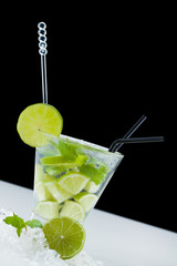 Mojito cocktail with limes and mint