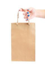 Paper bag in a female hand on white background.