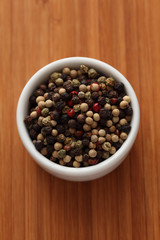 Mixed peppercorns in a bowl