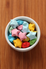 Colorful origami lucky stars in a bowl