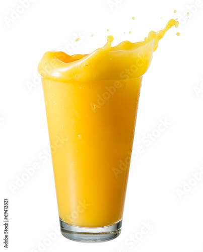 Orange juice. Splash in a glass, isolated on a white background - 69412821