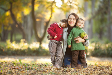 Family enjoying in a autumn park.