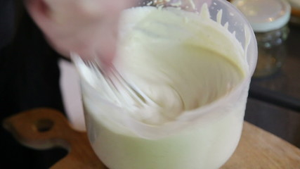 Hand mixing sauce with wire whisk