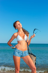 woman with jeans shorts and bag