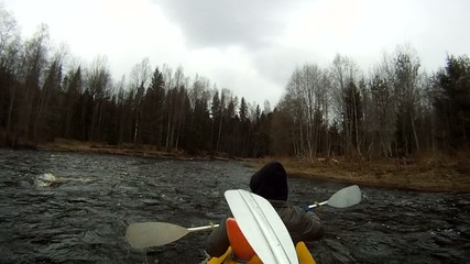 Rafting on a kayak  spring river