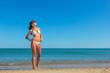 woman in bikini, outdoor on the beach