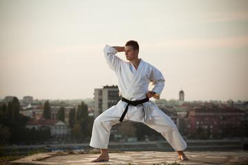 Man practicing martial arts outdoors