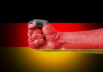 Flag Of Germany Painted On A Man's Fist