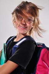 Happy smiling wearing eyeglasses schoolchild