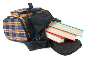 School backpack and books. On white background.