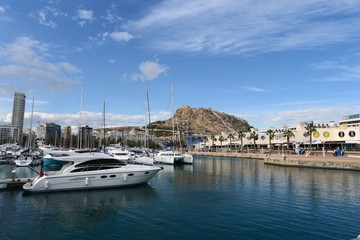 View of Alicante with yachts at sea.