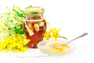 Honey with nuts and flowers