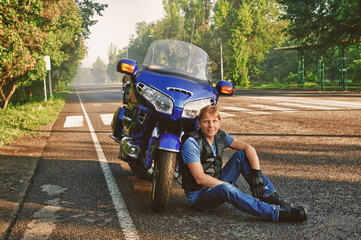 Motorcyclist with motorbike