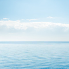 light cloud over blue sea