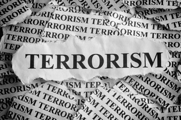 "Torn pieces of paper with the word ""Terrorism"""