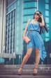 beautiful woman is walking in the modern city