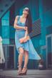 pretty woman is walking in the city