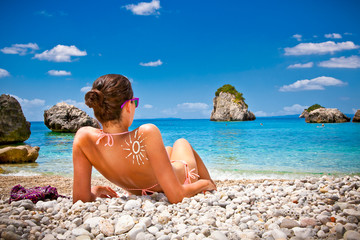 Beautiful woman on beach in Parga, Greece.