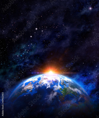 sunrise over earth in outer space