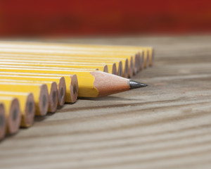 Pencils... one sharp surrounded by dull pencils