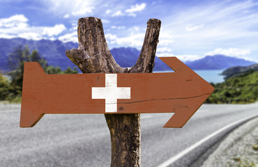 Switzerland wooden sign with a street background