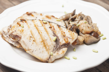 Grilled fish with mushrooms
