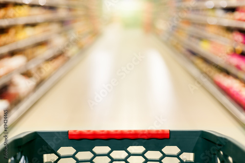 Tuinposter Boodschappen Shopping concept, supermarket in motion blur