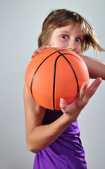child exercising with ball