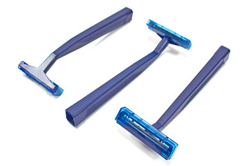 Blue razor blades isolated on white