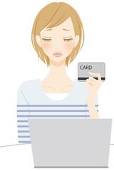 PC カードを持った困る女性