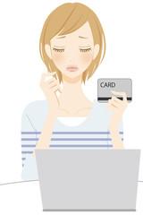 PC操作 カードを持った困る女性