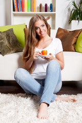Beautiful young woman having a cup of coffee