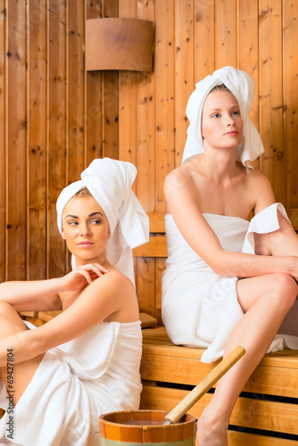 canvas print picture Girlfriends in wellness spa enjoying sauna infusion