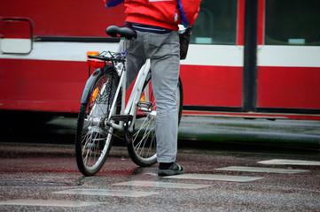 Man on bike, waiting, in traffic