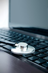 Diagnosis and repair of computers. Stethoscope on laptop