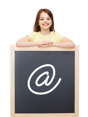 happy little girl with blackboard
