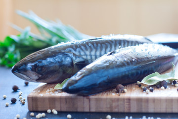 Fresh mackerel with spice and herbs on the board