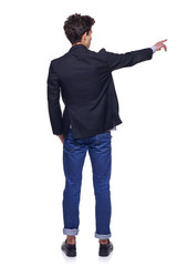Young man pointing, back view